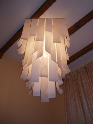 Ceiling lamp. Stainless steel, fabric strips. 850x 850x 1450 mm. Made for the particular interior. 2007